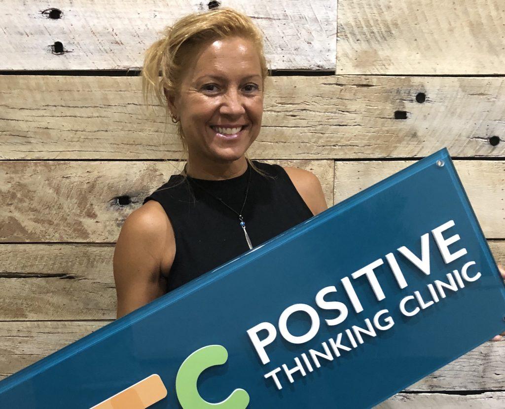 Amanda Dounis HOLDING PTC SIGN: DESTRESS WITH A MINDFULNESS SHOWER